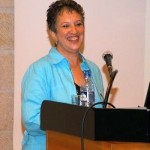 Anne lecturing at a Jerusalem symposium